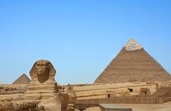 Rose Between Two Thorns. Lime top on Pyramid on the right which originally with would have been all the way down and covered with hieroglyphs and majestic sphinx Royalty Free Stock Image