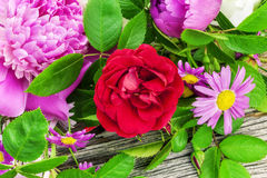 Rose with a variety of flowers Stock Photos