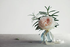 Rose in vase against light background, beautiful flower, vintage card. Copy space for text. Royalty Free Stock Photos