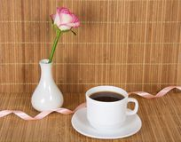 Rose in vase and cup with drink Stock Photography