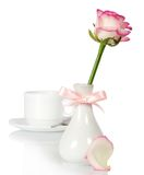 Rose in vase decorated by bow and tea-things Royalty Free Stock Photos