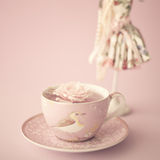 Rose on a vintage tea cup Royalty Free Stock Photo