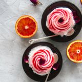 Rose water blood orange and vanilla ice-cream served on a plate. White stone background Royalty Free Stock Photo