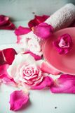 Bowl of aroma spa water with rose petals on towel, closeup Stock Photo