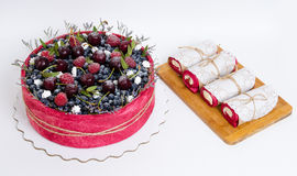 Rose wedding biscuit fruit cake with berries and some green Stock Photos