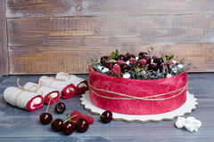 Rose wedding biscuit fruit cake with berries and some green Stock Image