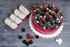 Rose wedding biscuit fruit cake with berries and some green Royalty Free Stock Photos