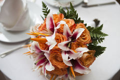 Rose wedding bouquet. Orange Rose wedding bouquet with pink lilies Stock Image