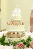 Rose wedding cake. Beautiful pink rose wedding cake on table at reception Royalty Free Stock Images