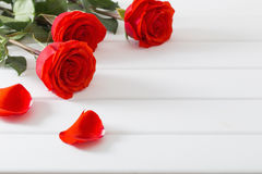 rose on white wooden table Stock Photo