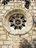 Rose-window. Rose window of the temple of Omisalj, Croatia. The text is written in ancient glagolotic alphabet, which is not in use nowadays Royalty Free Stock Image