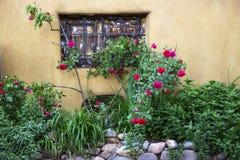 Rose Window Adobe Wall Lizenzfreies Stockfoto