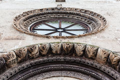 Rose Window. Architectural details of an antique church located in grottaglie, italy Royalty Free Stock Images