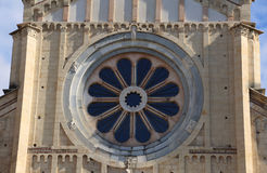 Rose window of the Basilica of San Zeno in Verona with the Wheel. Rose window in the facade of the Basilica of San Zeno in Verona in Italy with the Wheel of Stock Images