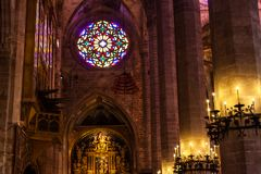 Rose window in the Cathedral of Santa Maria of Palma, also known as La Seu. Palma, Majorca, Spain. PALMA, MALLORCA, SPAIN - JUNE 23, 2018: Rose window in the Royalty Free Stock Images