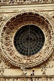 Rose window. St. Croce Basilica with man at work . Lecce - Salento - Italy. Rose window. St. Croce Basilica with man at work for maintenance Lecce - Salento Stock Photos