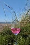 Rose wine on the beach Stock Photo