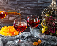Rose wine being poured into glasses Stock Photo