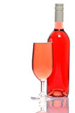Rose wine bottle and glass royalty free stock image