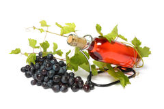 Rose wine bottle and grape. Isolated on white Royalty Free Stock Photos