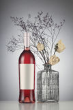 Rose wine bottle with label mockup. To withered white roses in a vase Stock Images