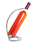 Rose wine bottle  in stand isolated on white background Stock Image