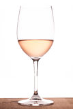Rose wine in a glass royalty free stock images