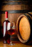 Rose wine in glass and bottle Stock Photography