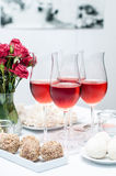 Rose wine in glasses, home party Royalty Free Stock Photo