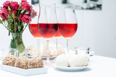 Rose wine in glasses, home party Stock Photos