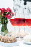 Rose wine in glasses, home party Stock Photo