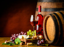 Rose wine, grapes and cheese Stock Photo