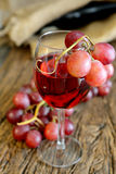 Rose wine and grapes Royalty Free Stock Images