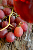 Rose wine and grapes Stock Photography