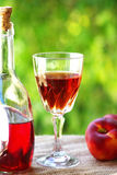 Rose wine and peachs. Royalty Free Stock Photo