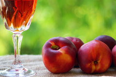 Rose wine and peachs. Royalty Free Stock Photography