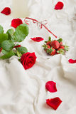 Rose, wine,  petals and strawberry Stock Images