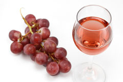 Rose wine and pink grapes Royalty Free Stock Photography