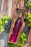 Rose wine in a wooden box Royalty Free Stock Photography
