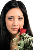 Rose Woman Close Up. Close up of a beautiful latina woman with a red rose royalty free stock photo