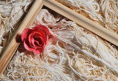 Rose and wooden frame on threads background Stock Images