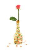 Rose y florero Foto de archivo libre de regalías