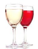 Rose y vino blanco en vidrios de un vino Fotografía de archivo