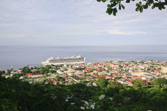 Roseau, Dominica. A general view of Roseau, capital of Dominca. It shows a cruise ship moored to the jetty and the city below the lookout. A tropical forest is Stock Photo