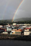 Roseau, Dominica, Caribbean Islands. Rainbow cross the sky of Roseau, the capital and largest city of Dominica royalty free stock photo