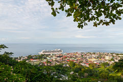 Roseau, Dominica, December 4, 2011. A view from the hill overlooking Roseau, capital of Dominca. a cruise ship is moored on the j royalty free stock image