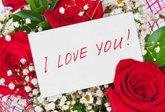 Roseblumenstrauß und Grußkarte Lizenzfreie Stockfotos