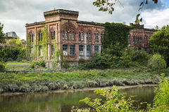 Rosefield Woollen Mills building Dumfries. A tall riverside frontage of a former woollen mill complex. Built in a symmetrical, Venetian manner, in brick with red Royalty Free Stock Photos