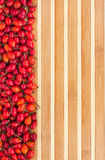 Rosehip on a bamboo mat Stock Photos
