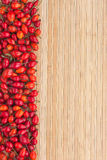 Rosehip on a bamboo mat Royalty Free Stock Photography